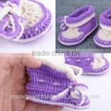 Violet and white handmade baby booties crocheted of wool and cotton for girl