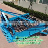 Agricultural tractor driven two rows harvest machine for potatos blue