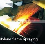 oxy-acetylene flamespraying to repair mechanical parts