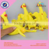 Hot selling cheap creative trick-playing toy yellow rubber chicken lays eggs toy, plastic keychain toy