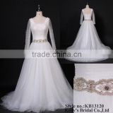 special pleating bodice tulle skirt with heavy beaded belt long sleeve wedding gown