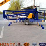 Towable boom lift for sale trailer mounted boom lift cherry picker for sale/tractor mounted corn picker