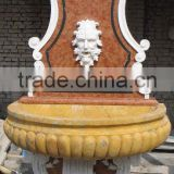 carved garden wall fountain