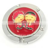 metal red foldable bag hanger with couple decoration for wedding gifts,weight capacity : 7kg