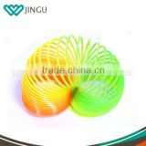 Hot toys for christmas plastic rocking toys for kids kids spring toys neon color rainbow circle spring