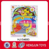 baby musical carpet with plastic rattle toy and plush animal toy