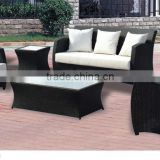 Black fabric covered sofa set with rattan wicker material chair set
