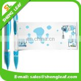 Transparent barrel with rubber grip roll out paper banner pens
