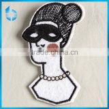 Unshaped embroidery label women head picture decoration patch with a safery pin on backside for women's blouse