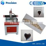 Mini low price cnc router machine/ mini desktop cnc router 6090/ mini cnc router woodworking
