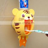 Automatic toothpaste dispenser, cartoon toothpaste dispenser, wash toothbrush holder