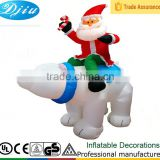 DJ-XT-65 inflatable christmas santa on polar bear with candy airblown music decoration