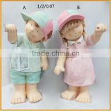 direct factory handmade polyresin standing baby boy and girl figurines with lantern