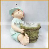 hotsale polyresin baby boy figurines with pots