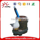 Polyresin pen holder with white bird statue