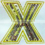 New Sequin Badge-- the Golden Letter X