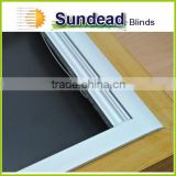Skylight blinds with blackout fabric C2 with silver coating at background, compatible with roof window frame