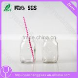 Food grade mason jar drinking glass with with lid and straw