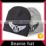 Knitted beanie hat with two balls in low price