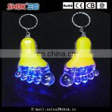 Wholesale hard plastic foot flashing led key chain