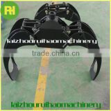 Hot wood grapple for trailer