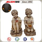 "14.2"" fiberglass resin girl statue holding solar butterfly, garden girl sculpture with solar animal"