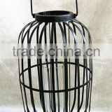 large metal lantern with clear glass cylinder