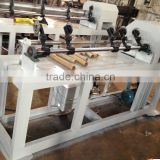 Adhesive tape roll paper core cutting machine