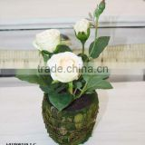 artificial rose in natural pot
