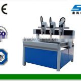 cnc cutting machine for PVC,plastic, acrylic,leather,metal,artificial stone,paper with multi-heads cnc wood router