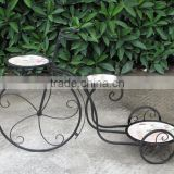 outdoor decorative bicycle shape antique rusty wrought iron flower pot stand. three pots stands