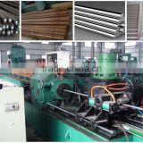 Round steel bar rod automatic peeling and straightening and polishing machine production line