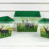 Garden decorative green painted metal rectangular plant pots with Christmas reindeer pattern