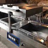 Meat product double chamber vacuum packaging machine