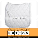 Gerneral purpose saddle pad with white polyester outer flannel backing 2silver cords billet and girth straps superior quilted