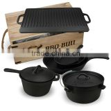 a set with wooden box cast iron camping cookware