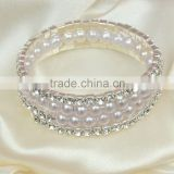Four rows crystal and rhinestone graduated wraparound coil bracelet