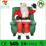 Inflatable animated Santa Claus sitting on chair for Christmas decorations