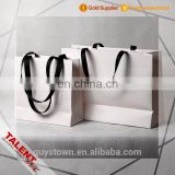 Custom emboss logo woven tape handle decorative craft paper bag