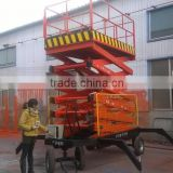 movable hydraulic scissor lift/four wheels mobile scissor electric lift platform / hydraulic aerial work platform