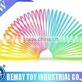 Promotional educational toys pull ring magic rainbow spring wholesale
