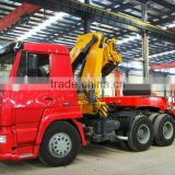 25tons steyr tractor head mounted crane(with low bed semi trailer)contact Mr. Tom song king 24 hours phone:TEL:+8615271357675