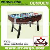 Telescopic Foosball, burled wood siding