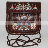 handstitched moroccan brown leather clutch with shoulder strap