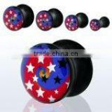 Black acrylic plug with red and blue star swirls