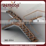 Modern wood cantilevered stairs with lowes wrought iron railings