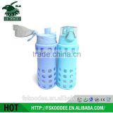 Light green color drink bottle with Bounce cover in glass material