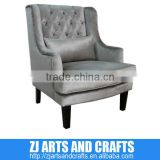 0475 modern sofa (Faux Velvet charcoal wing chair. With silver double studded arms and base with wenge finished legs.)