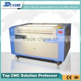 DSP control co2 fabric laser cutting machine 1390 with 100w RECI laser tube