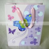 2013 deluxe brand laminated gift paper bag Custom PP Ribbon Handle Boutique Shopping Paper Bags